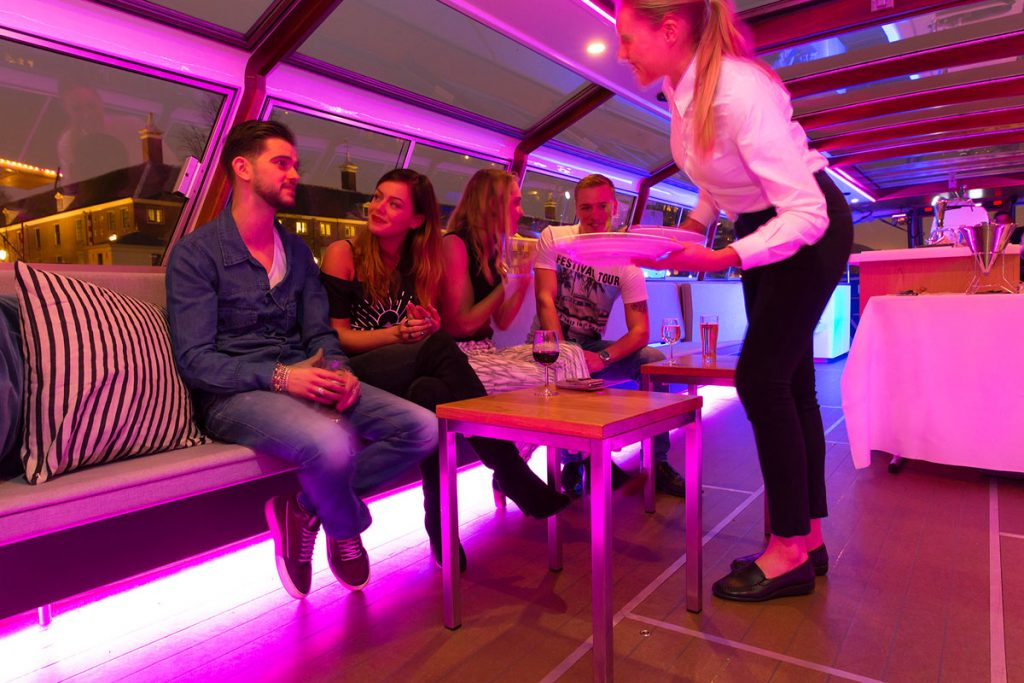 Canal boat hire Amsterdam Boat Tour - LIDO - Serving dinner in lounge area